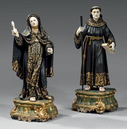 Paire de saints personnages en bois sculpté...