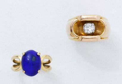 Bague chevalière en or 18 K ornée d'un diamant...