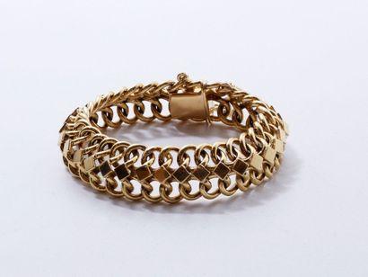 Bracelet en or 18 K, composé d'un tresse...