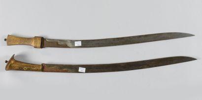 Deux sabres genre yatagan à poignées en laiton...
