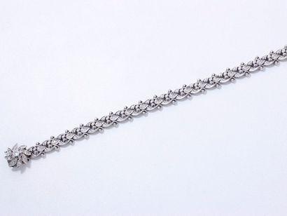 Bracelet articulé en or 585 millièmes, composé...