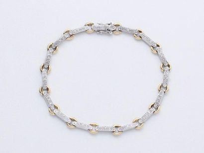 Bracelet ligne 2 ors 750 millièmes, composé...
