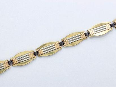 Bracelet 3 tons d'or 750 millièmes, composé...
