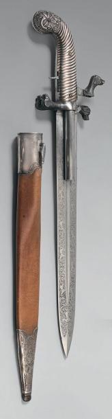 Dague de chasse à système formant pistolet, à percussion, par Dumonthier, poignée...