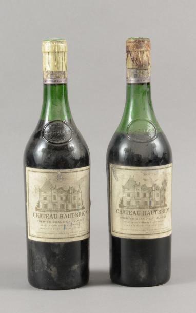 2 bouteilles CH. HAUT-BRION, 1° cru Pessac-Léognan...