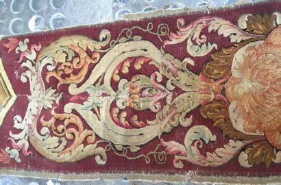 Fragment d'une bordure de tapis en laine,...