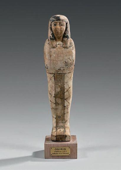 Ptah Sokar Osiris portant une longue perruque...