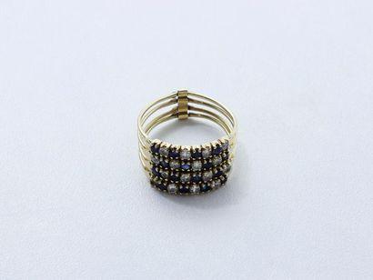 Bague en or 585 millièmes composée de 4 anneaux...