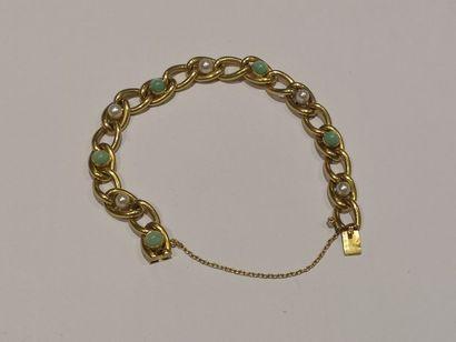 Bracelet gourmette en or jaune 750°/°° orné...
