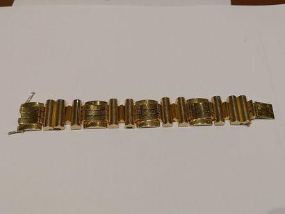 Bracelet tank en or 750°/°° (quelques chocs)...