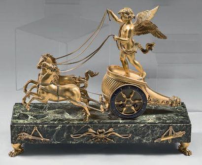 Pendule en bronze ciselé et doré sous la forme du char de l'Amour; le cadran annulaire...