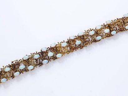 Bracelet articulé en or 585 millièmes décoré...