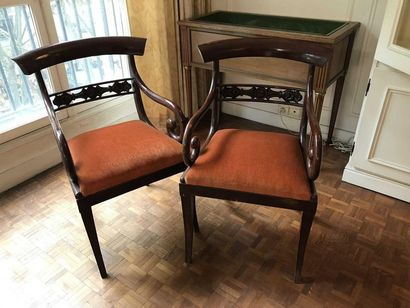 Pair of mahogany armchairs with rounded backs...