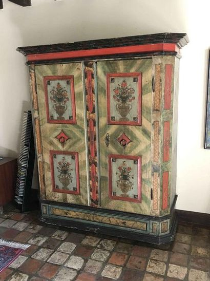 Painted wooden wardrobe decorated with floral...