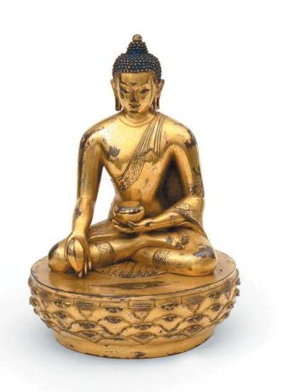 MONGOLIE Bouddha en bronze doré sur un socle de lotus stylisé. Manque la mandorle....