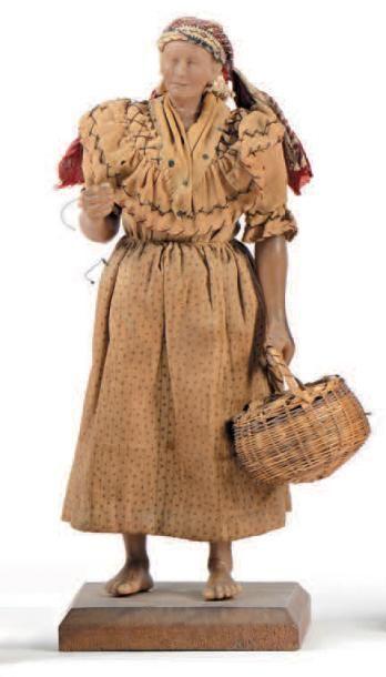 Personnage féminin de crèche en cire sculptée...