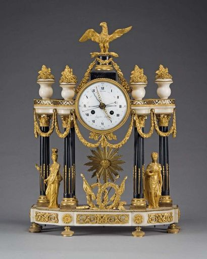 An important portico clock in white marble, black marble and gilt bronze, decorated...