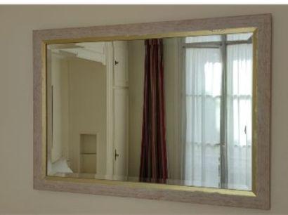 Trois miroirs rectangulaires en bois cérusé...