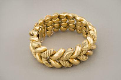 94. Bracelet en or jaune 750/1000e (18 carats)...