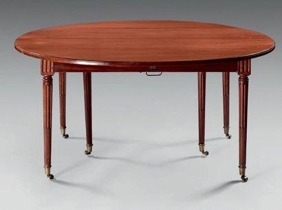 Grande table de salle à manger ronde en acajou...