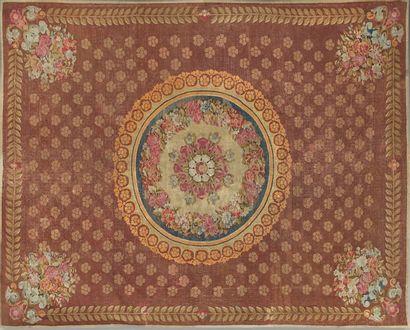 Grand tapis d'Aubusson orné d'une rosace...