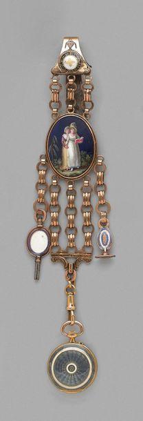 Châtelaine en or 585 millièmes et métal décorée...