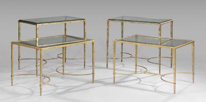 Quatre tables basses en bronze doré, pieds...