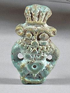 Amulette représentant le dieu Bès. Faïence...