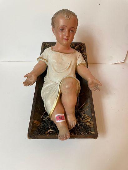 Enfant Jésus de crèche en plâtre peint. Largeur...