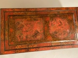 Coffee table with Chinese decoration, the top made of an old screen panel in red...