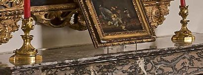 Paire de petits flambeaux en bronze doré à décor rocaille. Modèle de Jules Aurèle...