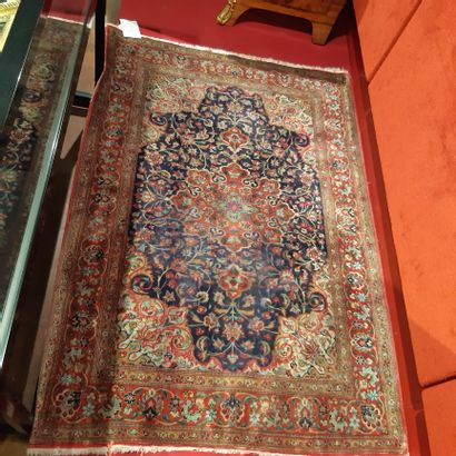 Small modern Persian carpet decorated with a medallion and spandrels on a blue foliage...