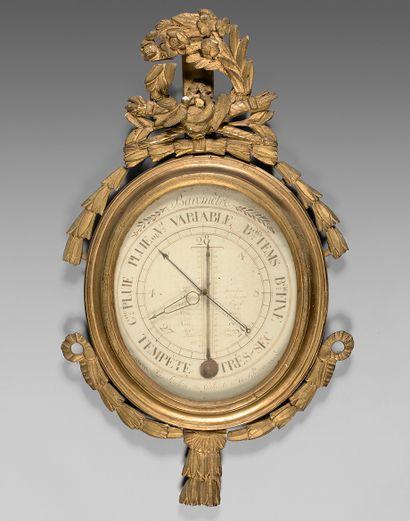 Baromètre-thermomètre dans un encadrement...