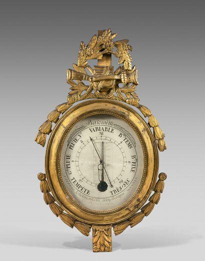 Thermomètre-baromètre dans un encadrement...