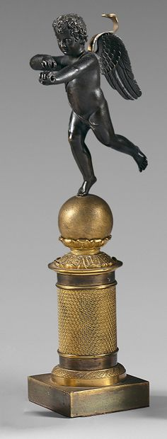 Statuette d'Amour archer en bronze patiné...