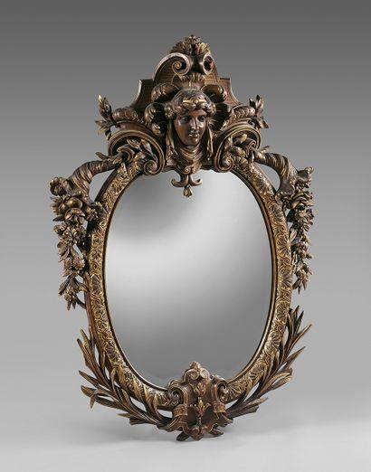 Grand miroir biseauté dans un encadrement...