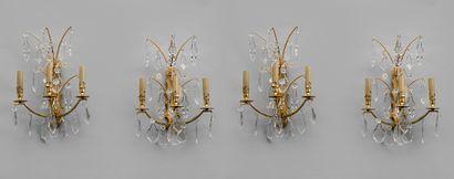Suite de quatre appliques en bronze doré...