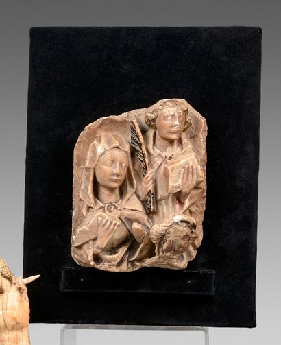 Haut-relief en albâtre à décor de deux saints...