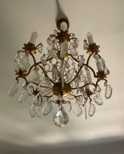 Lustre en bronze doré à huit bras de lumière,...