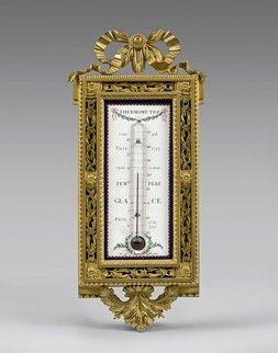 Thermomètre dans un encadrement en bronze...