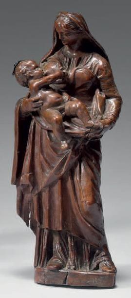 Statuette de Vierge à l'Enfant allaitant...