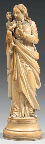 Vierge à l'Enfant tenant un coeur enflammé...