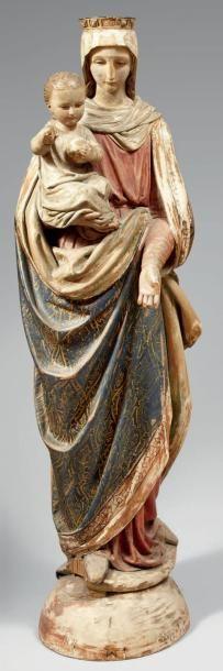 Statue de Vierge à l'Enfant en bois polychrome....
