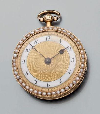 Petite montre de poche à clef en or jaune...