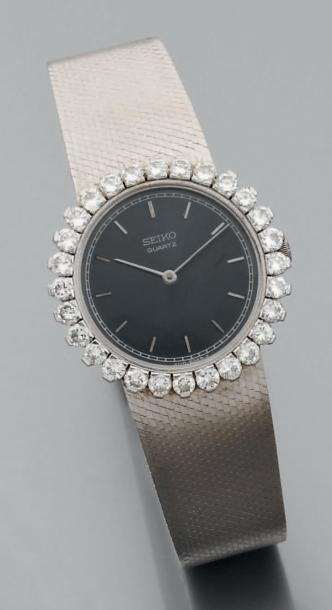 Montre-bracelet de dame ronde à quartz en...