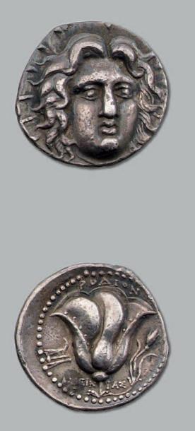 Tétradrachme. 13,46 g. Tête d'Hélios de face,...