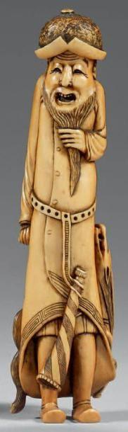 Netsuke en ivoire à patine jaune et jaune...
