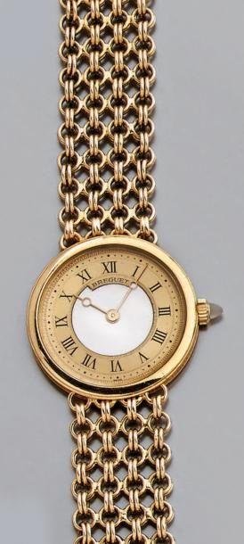 Montre-bracelet de dame, ronde, en or jaune,...