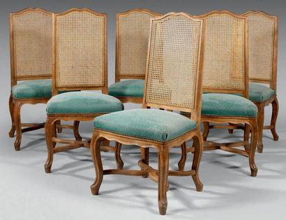Six chaises à dossiers plats cintrés cannés....