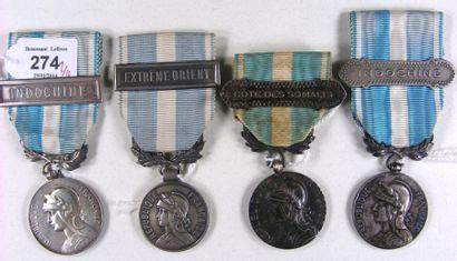 Lot de quatre médailles coloniales: deux à bélière biface en argent du premier type...